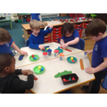 Creating repeating patterns by pressing 3D shapes into playdough.