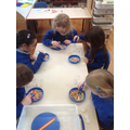 Fine Motor skills. We used tweezers to sort the beads. We sorted all the primary colours