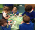 Here in our Fine Motor Skills we were carefully placing small beads to decorate the trees.