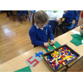 Making 4 and 5 Lego numerals.