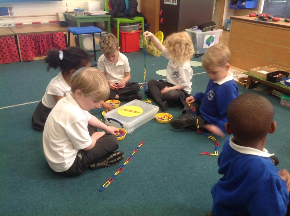 Practicing our fine motor skills using links.