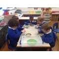 Fine Motor skills. We used tweezers to sort the beads. We sorted all the primary colours.