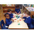 We practiced our rolling skills to cut Christmas shapes out of playdough.