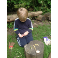 Pealing off the Elder bark to create the wooden beads.
