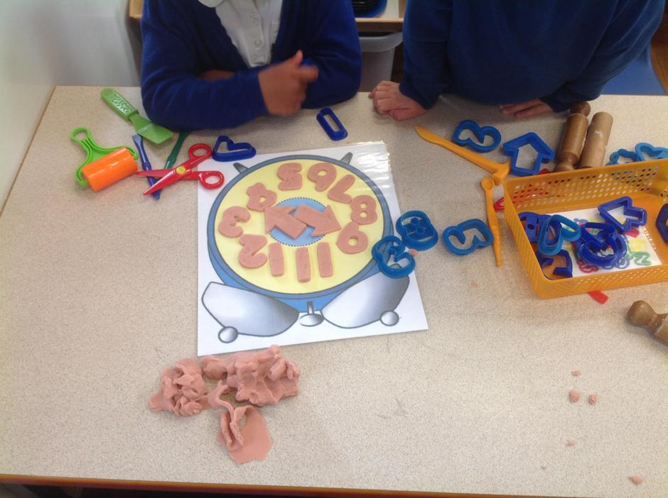 Creating a clock face from playdough.