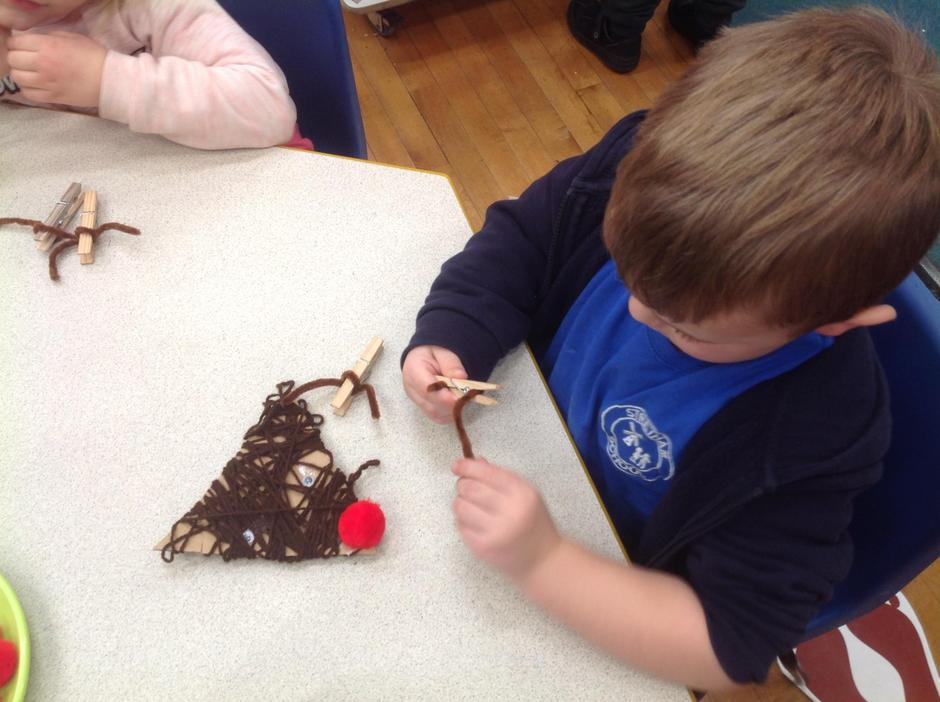 We turned our wrapped triangles into reindeers!