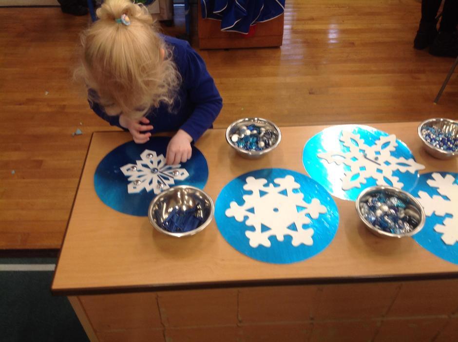 Creating beautiful snowflakes using loose parts.
