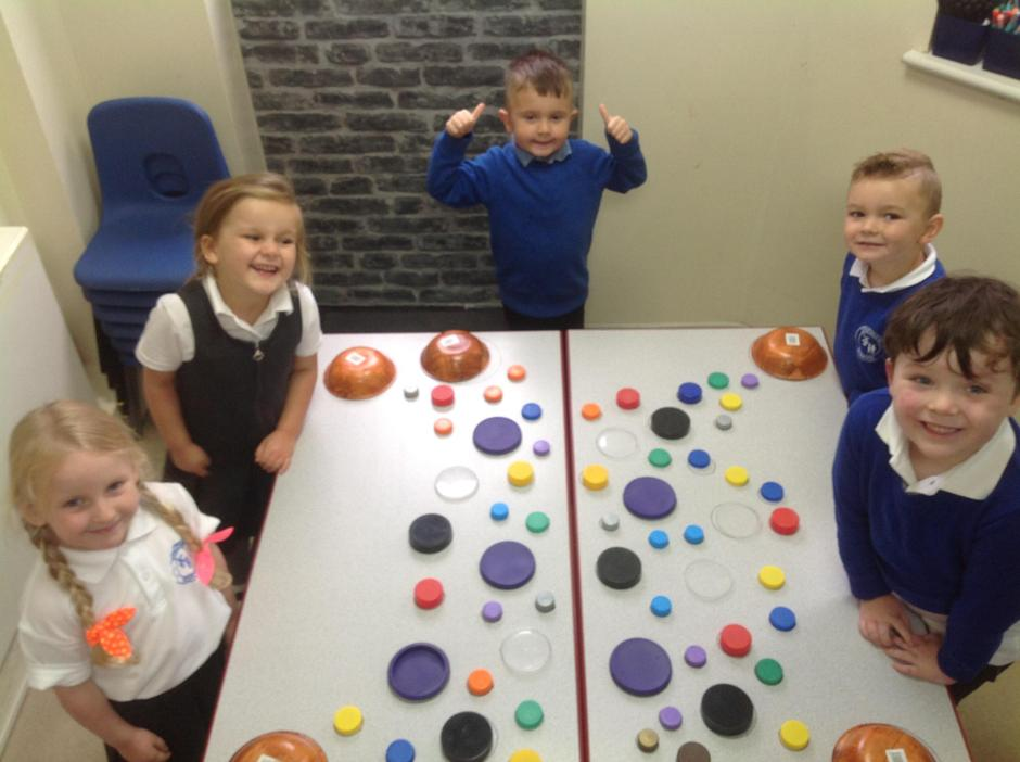 The children discussed the various sizes of each lid.