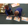 Working out our money so we can buy our snack.