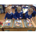 Segmenting and blending to spell words.