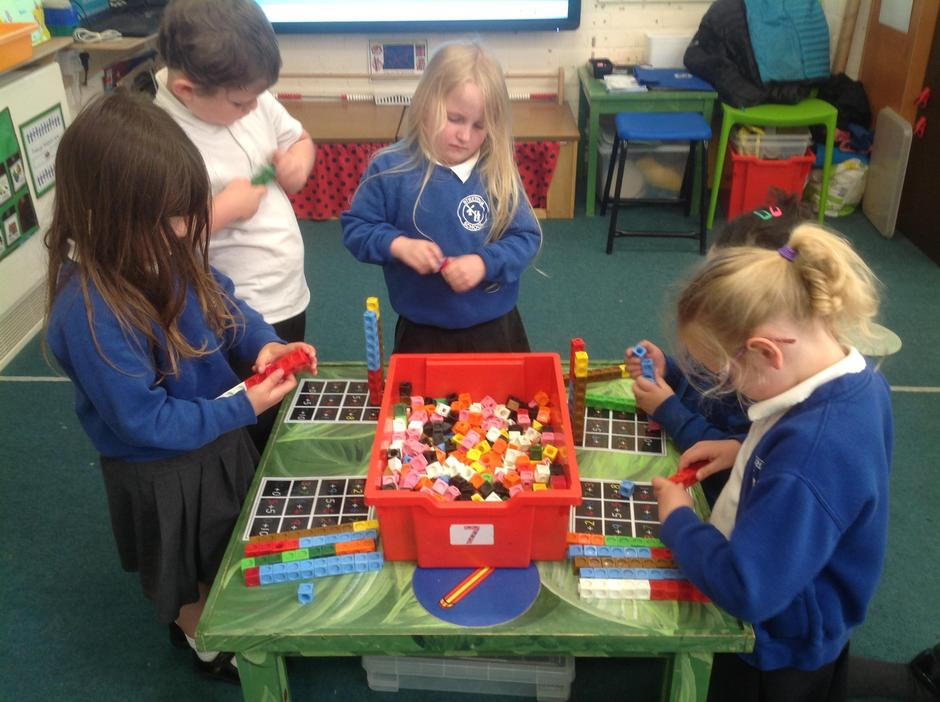 Using our maths and PD skills to create addition towers.