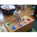 Developing fine motor skills by sorting coloured bears.
