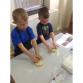 Gently rolling the dough.