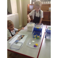 Team work to weigh out the flour.
