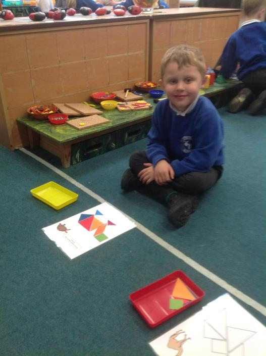 Tangrams to create an animal picture.