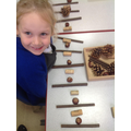 Using natural objects we practised creating and repeating patterns.