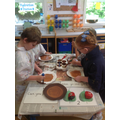 Independently following instructions at the painting table to make a hedgehog.