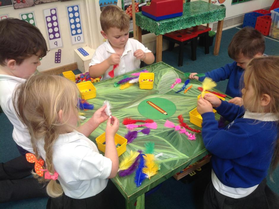We threaded matching coloured beads onto feathers.