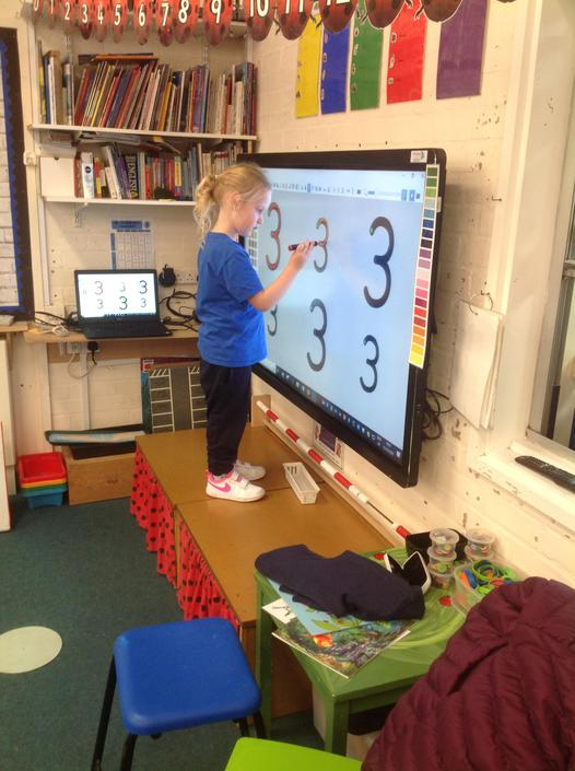 We practised correct formation of number three on the interactive whiteboard