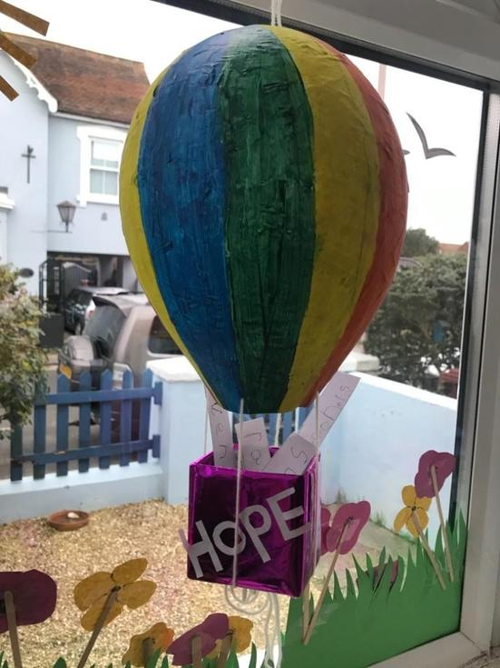 "Lydia's ""Floating Hope"" with what makes you feel hopeful and happy messages in the basket"