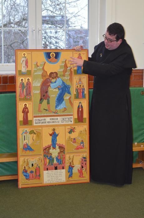 Father Philip shows us the Pax Christi Icon.