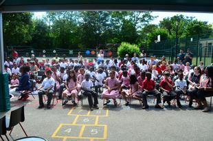 Parents and Children enjoy Proms in the Playground