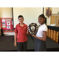 Hope House Captains receive the Sports Day Shield.