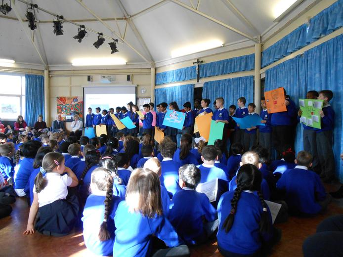 Year 6 sharing their learning in assembly