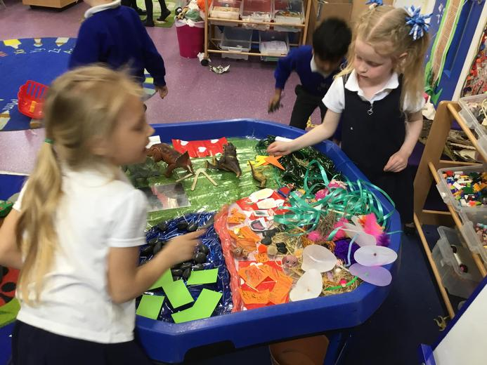 Creating their own Small World Play
