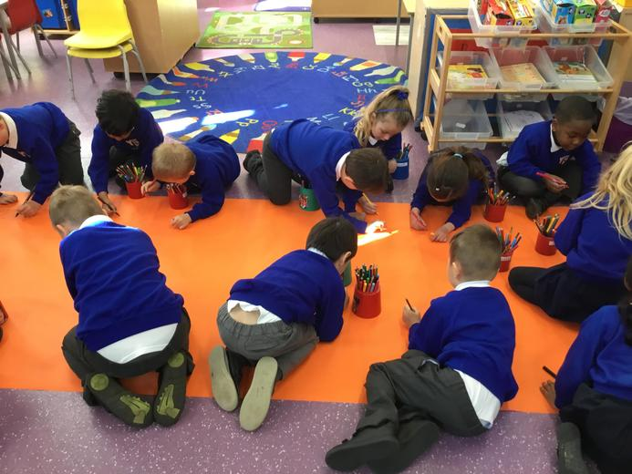 We were learning about the 'ai' sound. We make a giant class 'train' picture.