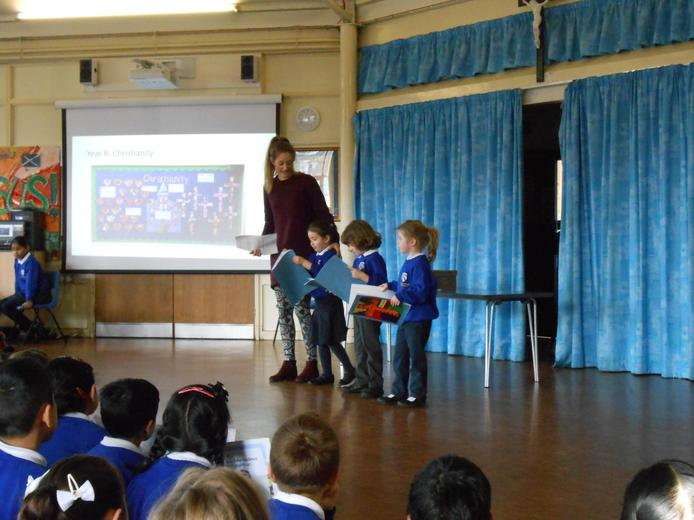 Reception sharing their learning in assembly
