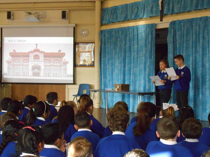 Year 5 sharing their learning in assembly