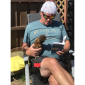 Mr Smith enjoys reading with his chicken!