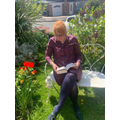 Miss Marsden's reading in her lovely garden