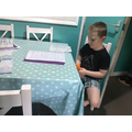 Keelen using cubes to help him with his maths