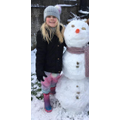 Look at Lydia's snowman. It is almost as tall as she is. Love the accessories.