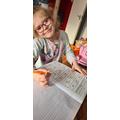 Klaudia completing her materials worksheet