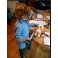 Anastasia is doing a great job measuring.