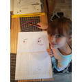 Emilia's drawings showing sad and happy emotions