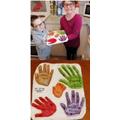Liam made salt dough handprints of his family.