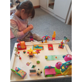 Emilia creating her town
