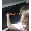 Harriet peeling carrots for stew