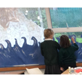 Alaska and Isla painting our new classroom display