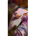 Evie writing her spellings carefully and using a finger space- Well done Evie.