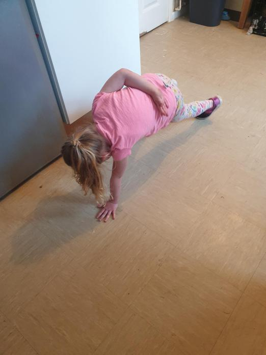 Alivia has been doing cosmic yoga each day.