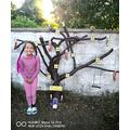 Leila helped paint a fairy tree