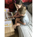 Keelen reading with his sister.