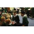 YR 1 children enjoying story time.