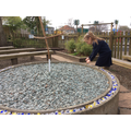 Every child and adult put a bead in our prayer garden