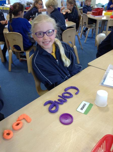 Zara creatively practising her spellings!